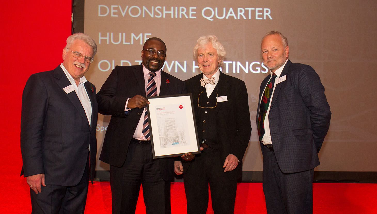 Symon Sentain AoU collects the Great Neighbourhood award on behalf of Hastings' Old Town
